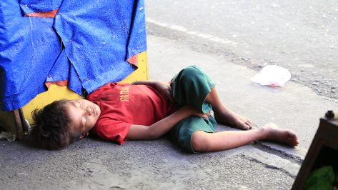 stock-footage-cebu-philippines-march-poverty-in-philippines-a-unidentified-boy-sleeping-on-the